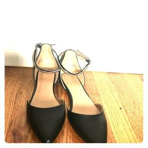 Black pointed toe flat with gold ankle strap